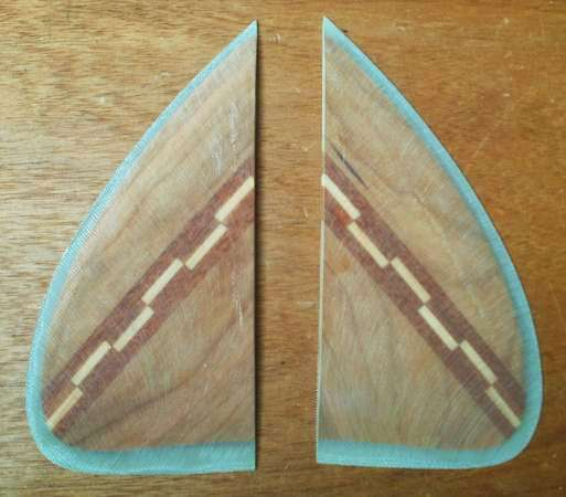 Traditional wooden glass-on keel fins for a surfboard