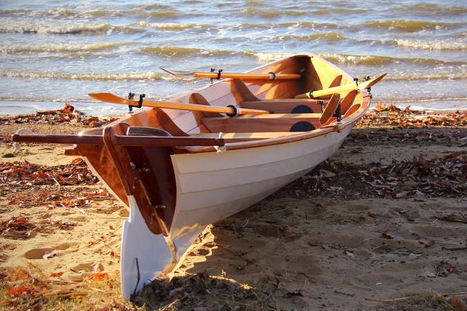 Team Dory wooden racing boat for four rowers