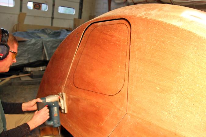 Cutting out the doors of the teardrop caravan