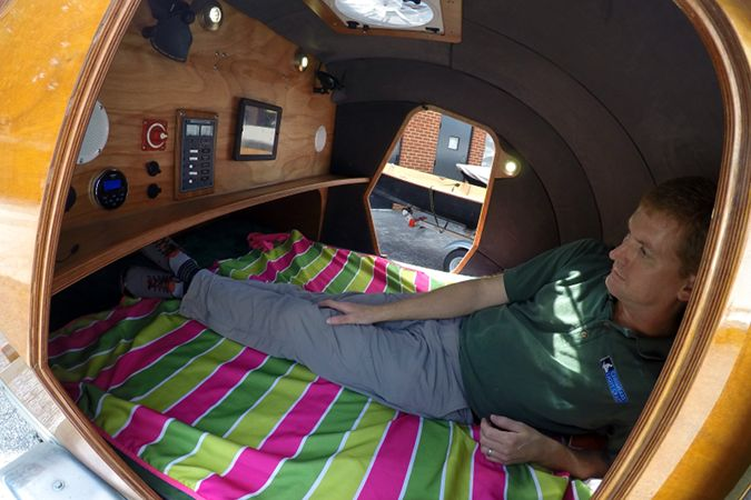 The spacious interior of the stitch-and-glue teardrop camper comfortably fits two adults