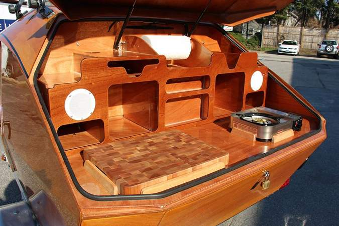 The Teardrop Camper has a large galley in the rear locker