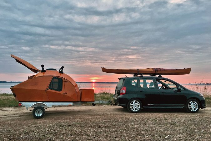 The stitch-and-glue teardrop camper can be towed by a small car
