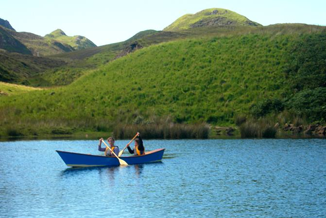 Children exploring a Scottish loch in a canoe from Fyne Boat Kits