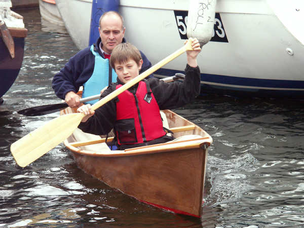 Father and son in home made canoe kit