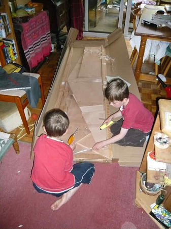 A Fyne Boat Kit canoe arrives and is unpacked by the children
