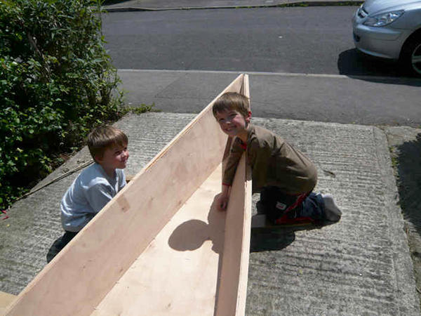 Stitching a wooden canoe together in the garden