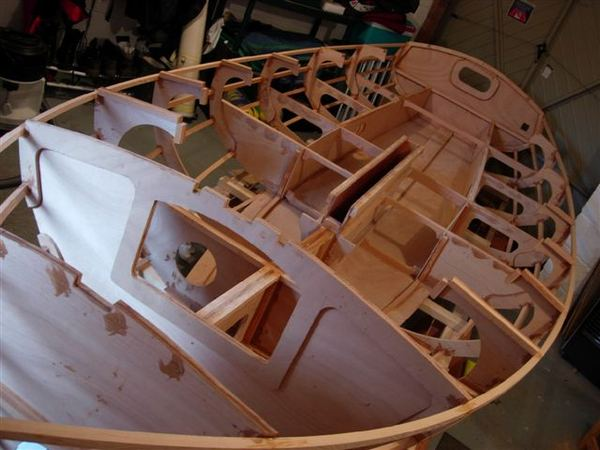 Building a Navigator from a Fyne Boat Kit - stringers being attached to the bulkheads