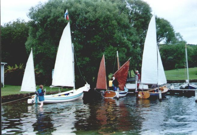 Three 15 foot home built Navigator sailing boats sailing in together