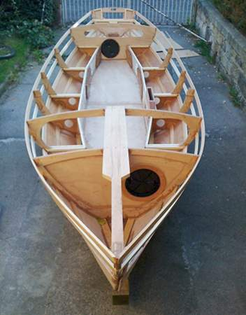 Wooden sailing boat Walkabout being built at home