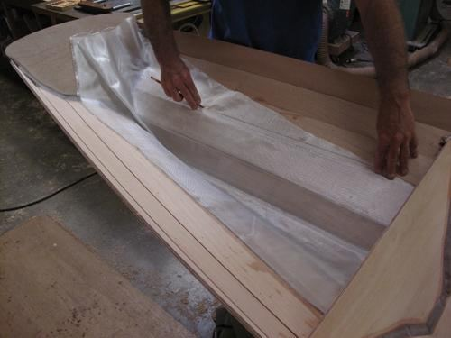 Wetting out fabric with professional epoxy coatings when building a stitch and glue rowing boat