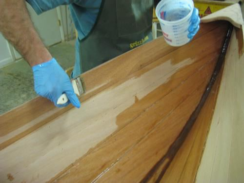 Applying professional epoxy coating to a wooden wherry kit
