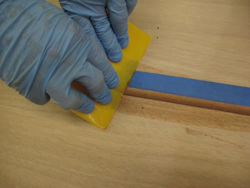 Scraping epoxy on a tandem rowing wherry kit
