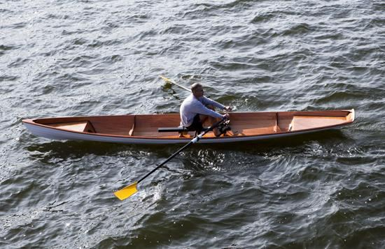 One person rowing a light weight two person rowing wherry from clc