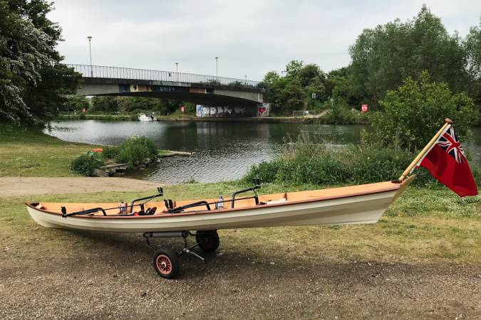 Tandem Wherry wooden rowing boat on the river Thames