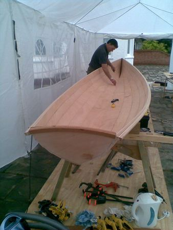 Building a rowing boat in a tent in your garden with the help of fyne boat kits