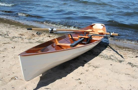 A self built rowing wherry on a beach ready for a sea launch