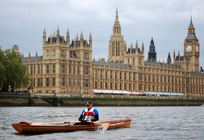 Home built wherry rows on Thames past Houses of Parliament London made from a Fyne Boat Kit