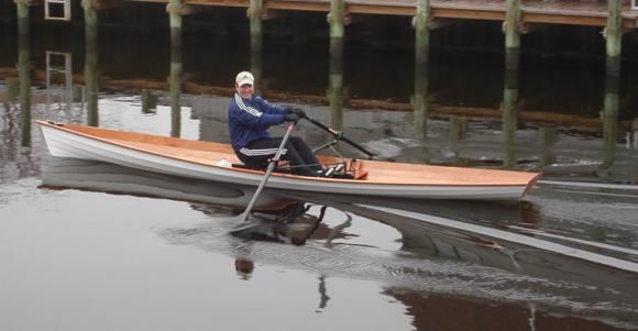Lightweight wooden wherry rowing boat has a very fast turn of speed