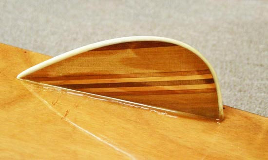 Laminated wooden fins on a Kaholo stand-up paddleboard