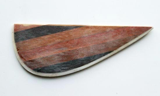 Laminated wooden fin for a paddleboard