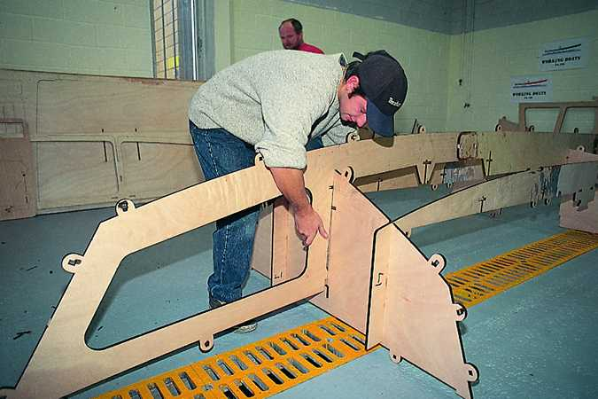 Building the Workstar motorboat uses a slot-together system of tabs, slots and wedges