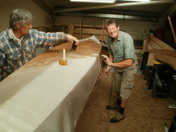 Chesapeake Triple kayak supervised build – applying glass fabric